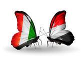 Farfalle con bandiere di cote divoire e yemen — Foto Stock