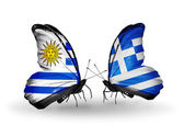 Borboletas com bandeiras uruguai e grécia — Fotografia Stock