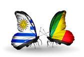 Motyle z Urugwaju i kongo flagi — Zdjęcie stockowe