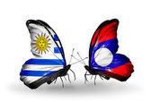 蝴蝶与乌拉圭和老挝国旗 — 图库照片