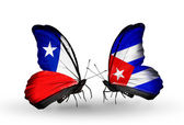 Butterflies with Chile and Cuba flags — Stock Photo