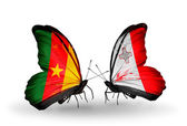 Butterflies with Cameroon and Malta flags — Stock Photo