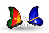 Butterflies with  Cameroon and Nauru flags — Stock Photo