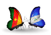Butterflies with Cameroon and Nicaragua flags — Stock Photo