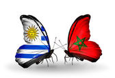 Butterflies with Uruguay and Morocco flags — Stock Photo