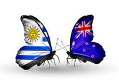 Butterflies with Uruguay and New Zealand flags — Stock Photo
