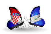 Butterflies with Croatia and Nicaragua flags — Stock Photo