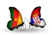 Butterflies with Cameroon and Serbia flags — Stock Photo