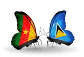 Butterflies with  Cameroon and Saint Lucia flags — Stock Photo