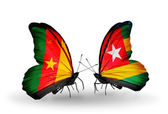 Butterflies with Cameroon and Togo flags — Stock Photo