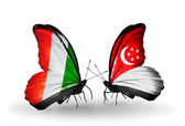 Butterflies with Cote Divoire and Singapore flags — Stock Photo