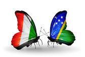 Butterflies with Cote Divoire and Solomon Islands flags — Stock Photo