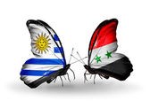 Butterflies with Uruguay and Syria flags — Stock Photo