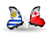 Butterflies with Uruguay and Tonga flags — Stock Photo