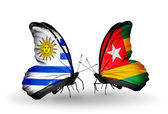 Butterflies with Uruguay and  Togo flags — Stock Photo