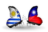 Butterflies with Uruguay and Taiwan flags — Stock Photo