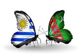 Butterflies with Uruguay and Turkmenistan flags — Stock Photo
