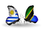 Butterflies with Uruguay and Tanzania flags — Stock Photo