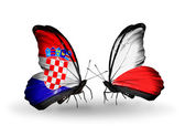Butterflies with Croatia and Poland flags — Stock Photo