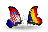 Butterflies with Croatia and Chad, Romania flags — Stock Photo