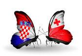 Butterflies with Croatia and Tonga flags — Stock Photo