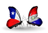 Butterflies with Chile and Paraguay flags — Stock Photo