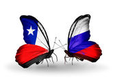 Butterflies with Chile and Russia flags — Stock Photo