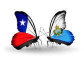 Butterflies with Chile and San Marino flags — Stock Photo