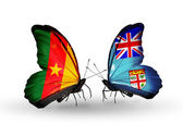 Butterflies with Cameroon and Fiji flags — Stock Photo