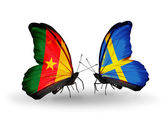 Butterflies with Cameroon and Sweden flags — Stock Photo
