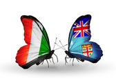 Butterflies with Cote Divoire and Fiji flags — Stock Photo