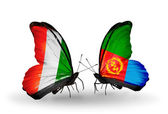Butterflies with Cote Divoire and Eritrea flags — Stock Photo