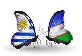 Butterflies with Uruguay and Uzbekistan flags — Stock Photo