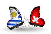 Motyle z urugwaju i szwajcaria flagi — Zdjęcie stockowe
