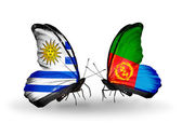 Butterflies with Uruguay and Eritrea flags — Stock Photo