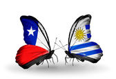 Butterflies with Chile and Uruguay flags — ストック写真
