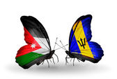 Butterflies with Jordan and Barbados flags on wings — Stock Photo