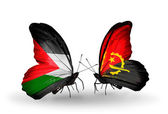 Butterflies with Palestine and  Angola flags on wings — Stock Photo