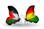 Butterflies with Palestine and Bolivia flags on wings — Stock Photo