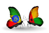Butterflies with Ethiopia and Guinea Bissau flags — Stock Photo