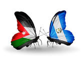Butterflies with Jordan and Guatemala flags — Stock Photo