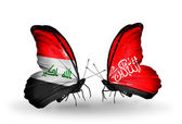 Butterflies with Iraq and   Waziristan flags — Стоковое фото