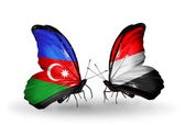 Butterflies with Azerbaijan and Yemen flags — Stock Photo