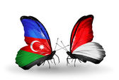 Butterflies with Azerbaijan and Monaco, Indonesia flags — Stock Photo
