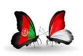 Butterflies with Afghanistan and Monaco, Indonesia flags — Stock Photo