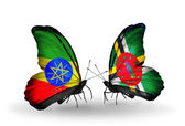Butterflies with Ethiopia and Dominica flags — Stock Photo