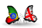 Butterflies with Ethiopia and Georgia flags — Stock Photo