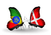Butterflies with  Ethiopia and Denmark flags — Stock Photo