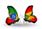 Butterflies with Ethiopia and Grenada flags — Stock Photo