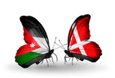 Butterflies with Jordan and Denmark flags — Stock Photo